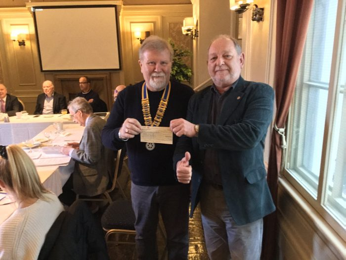 Features Rotarian receiving £500 for sport of the Satellite group