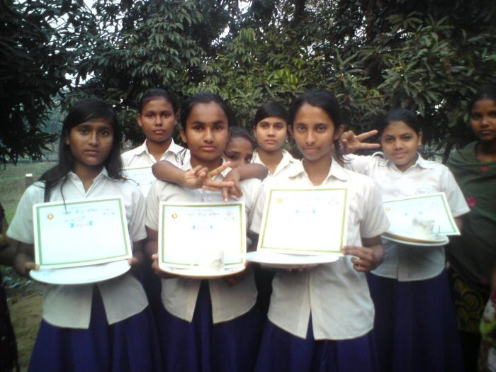 Group of girls from the academy proudly holding their certificates of achievement
